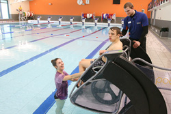 Student testing out the new pool pod in his wheelchair