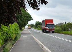 red lorry on road