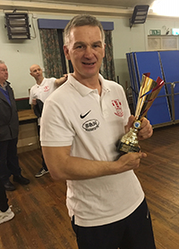Boxing coach holding a gold trophy