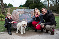 The family of Isla Tansey beside the memorial plaque to Isla 'smiler'