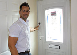 Man pointing to button on door