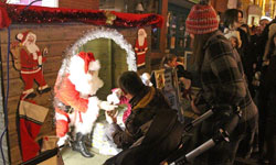 Father Christmas giving gifts in his Grotto