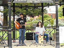 Two musicians performing in Argents Mead bandstand