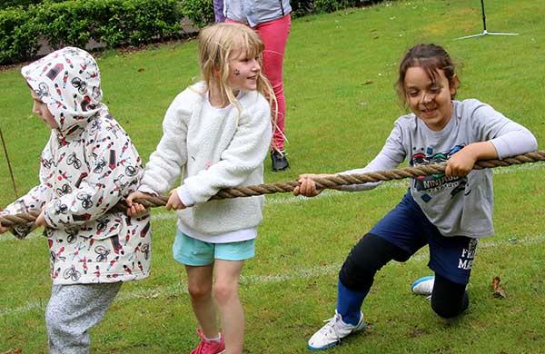 Children pulling rope