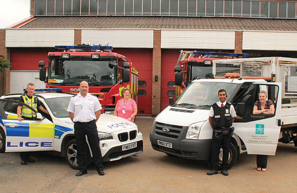 Police, fire and council staff with vehicles